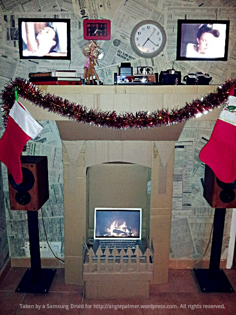 This is too awesome not to share. My friends Graeme and Eleanor made this green fireplace for Christmas with a glue gun